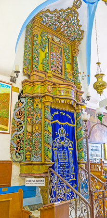 SAFED, ISRAEL - FEBRUARY 22, 2016: The carved medieval Torah Arc in Ari Ashkenazi Synagogue, decorated with floral patterns and image of a lion on its top, on February 22 in Safed.