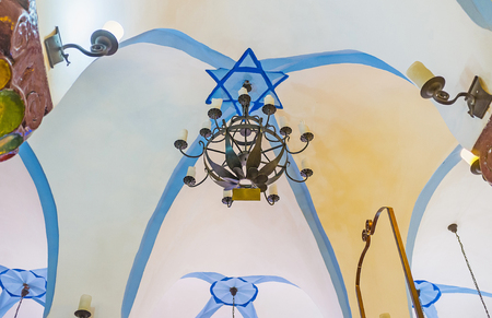SAFED, ISRAEL - FEBRUARY 22, 2016: The white ceiling of Ari Ashkenazi Synagogue, decorated with blue Davids Star, on February 22 in Safed.
