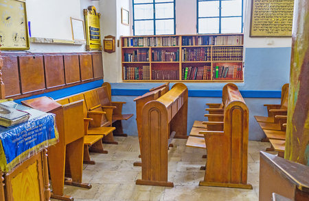 ashkenazi: SAFED, ISRAEL - FEBRUARY 22, 2016: The chairs for Torah readers and the book shelves in Ari Ashkenazi Synagogue, on February 22 in Safed.