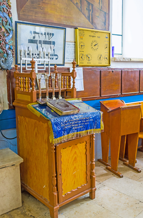 ashkenazi: SAFED, ISRAEL - FEBRUARY 22, 2016: The bima pulpit in Ari Ashkenazi Synagogue with Menorah on it, on February 22 in Safed.