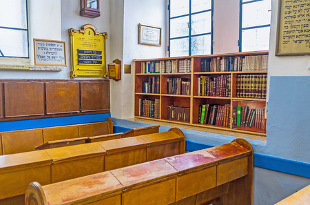 ashkenazi: SAFED, ISRAEL - FEBRUARY 22, 2016: The small library next to the worshipers benches in Ari Ashkenazi Synagogue, on February 22 in Safed. Editorial