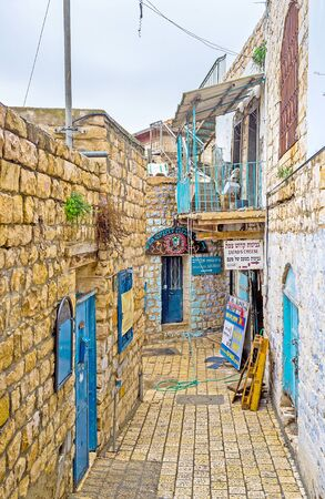 galilee: SAFED ISRAEL - FEBRUARY 22 2016: The narrow stone street of the oldtown located in highlands of Galilee on February 22 in Safed. Editorial