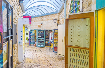 mezuzah: SAFED, ISRAEL - FEBRUARY 22, 2016: The stalls of Gallery street offers handmade jewelries and wide range of mezuzahs, on February 22 in Safed. Editorial