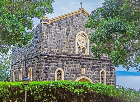 primacy: The Church of the Primacy of St Peter located in shady garden on the bank of Kinneret Lake, also known as the Sea of Galilee, Tabgha, Israel.