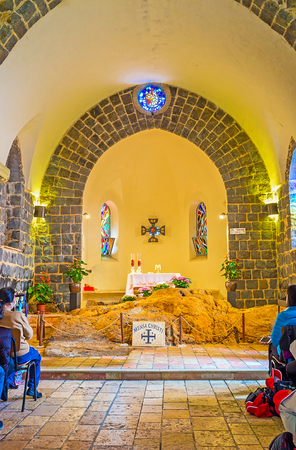TABGHA, ISRAEL - FEBRUARY 22, 2016: The prayer hall of the Church of the Primacy of St Peter with the large limestone block at the Altar, named Mensa Christi (the Table of Christ), on February 22 in Tabgha.