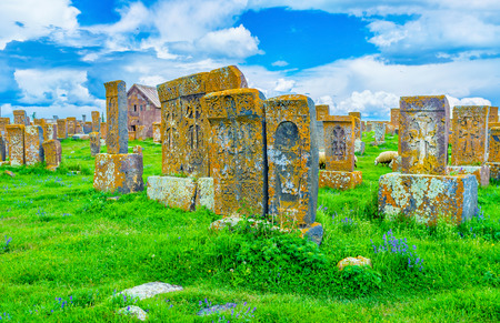 The old khachkars boast complex carved patterns, not repeated and unique, Noratus Cemetery, Gegharkunik Province, Armenia. Stock Photo