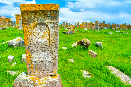 The stone khachkar covered with the carved religious ornaments with many different crosses, Noratus Cemetery, Gegharkunik Province, Armenia.