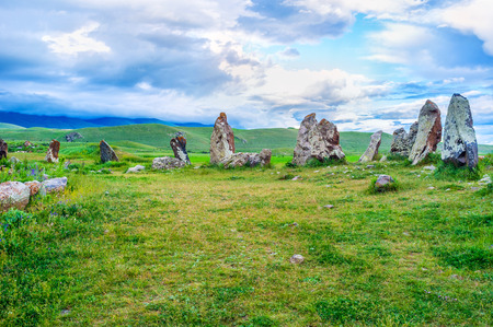 The huge boulders of  Zorats Karer guard their meadow since old times, standing like the brave knights among the highlands, Syunik Province, Armenia. Stock Photo