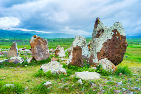 archaeological site: The ancient boulders, covered with lichen and moss, connected into the circles, forms archaeological site of Zorats Karer, Sisian, Syunik Province, Armenia. Stock Photo