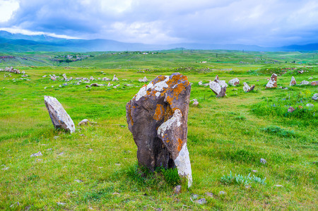 The boulder in Zorats Karer archaeological site, covered with different colored lichen, Sisian, Syunik Province, Armenia.