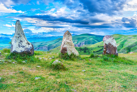 archaeological site: The colorful clouds over the stones of Carenish archaeological site, also famous as Zorats Karer, Sisian, Syunik Province, Armenia. Stock Photo