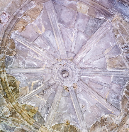 archaeological site: VARDZIA, GEORGIA - MAY 27, 2016: The stone decoration on the ceiling of old tower at the entrance to Vardzia archaeological site, Samtskhe-Javakheti Region, on May 27 in Vardzia. Editorial