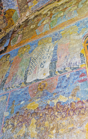 frontage: VARDZIA, GEORGIA - MAY 27, 2016: The preserved frescoes on frontage wall of Dormition Church, the main landmark of archaeological site, on May 27 in Vardzia. Editorial