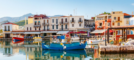 rethymno: The old port is the popular tourist location, there are a lot of fishing and tourist boats for hire, cafes and taverns to relax and taste the local cuisine, Rethymno, Greece. Stock Photo