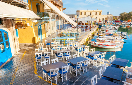RETHYMNO, GREECE - OCTOBER 16, 2013: The old harbor can be named the gourmets' street, the local outdoor restaurants are the best in old town, on October 16 in Rethymno.