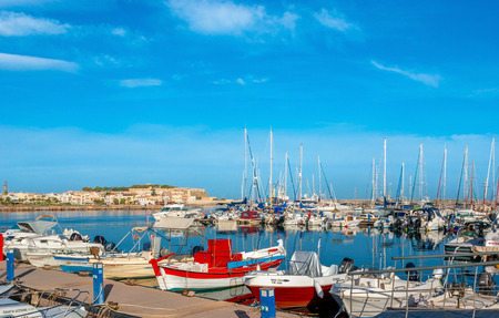 RETHYMNO, GREECE - OCTOBER 16, 2013: The  new port is located aside of the old town and contains a lot of yachts and boats, on October 16 in Rethymno.