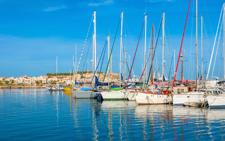 fortezza: The scenic yachts with the Fortezza citadel and the old town promenade on the background, Rethymno, Crete, Greece.