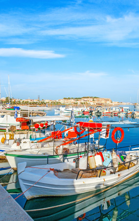 The nice resort on the coast of Aegean Sea with wide range of attractions, including different trips from the new port and old harbor, Rethymno, Crete, Greece.