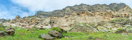 impregnable: The steep rocky slope of Erusheti Mount looks pretty impregnable, the connection between medieval monastic complex of Vardzia was made with secret passes, carved inside of the rock, Samtskhe-Javakheti Region, Georgia.