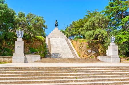 AJACCIO, FRANCE - MAY 2, 2013: The memorial complex of  Napoleon Bonaparte in Place dAusterlitz, the statue of Emperor atop the tall stairway, on May 2 in Ajaccio.