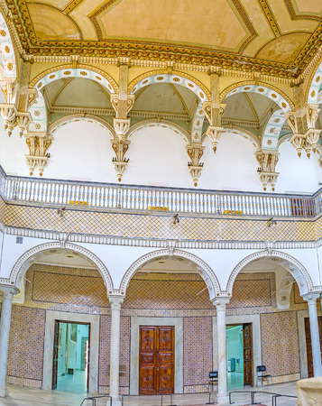 grecas: TUNIS, TUNISIA - SEPTEMBER 2, 2015: The Carthage Room of Bardo National Museum decorated with traditional fretwork, glazed tiles and slender stone pillars, on September 2 in Tunis. Editorial
