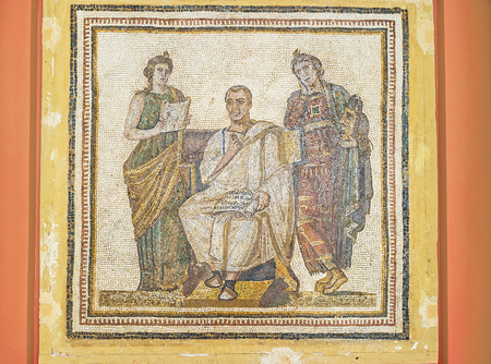 virgil: TUNIS, TUNISIA - SEPTEMBER 2, 2015: The mosaic picture with Virgil, writing the Aeneid poem, inspired by the muses, Clio and Melpomene, Bardo National Museum, on September 2 in Tunis.