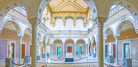 grecas: TUNIS, TUNISIA - SEPTEMBER 2, 2015: Panorama from arcade of the Carthage Room of Bardo National Museum, decorated with fretwork, glazed tiles and ancient statues, on September 2 in Tunis.