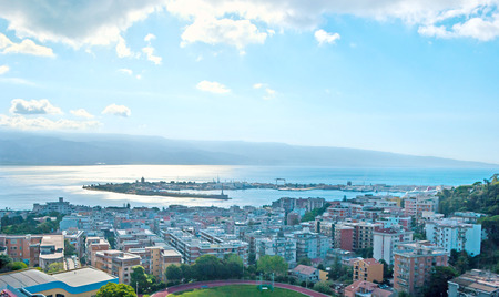 ionian: MESSINA, ITALY - OCTOBER 2, 2012: The aerial view of the city, its port, Messina Strait and Reggio Calabria of Italian mainland on other shore, on October 2 in Messina.