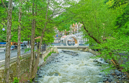 water sources: The modern bridge over Borjomula river, located next to the luxury Crowne Plaza Hotel and Borjomi Park with famous mineral water sources, Georgia. Stock Photo