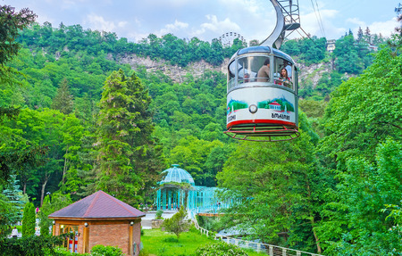 cableway: BORJOMI, GEORGIA - MAY 27, 2016: One of the favorite tourist attractions in resort is the cable car ride over the Mineral Water Park and Borjomi Gorge, on May 27 in Borjomi. Editorial