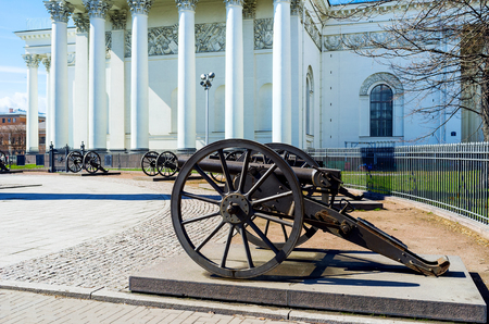 colonnade: The old Turkish cannons surround the Memorial Column, located at the Trinity Cathedral in Izmailovsky Prospekt, St Peterburg, Russia.
