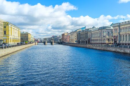 The embankments of Fontanka River with old mansions and great palaces and the Lomonosov bridge in front, St Petersburg, Russia. Editorial