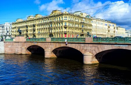 SAINT PETERSBURG, RUSSIA - APRIL 25, 2015: The best way to enjoy the Anichkov Bridge with the masterpiece statues of Horse Tamers by Pyotr Klodt, is to overlook it from Fontanka River embankment, on April 25 in Saint Petersburg. Editorial