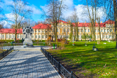 SAINT PETERSBURG, RUSSIA - APRIL 25, 2015: The cemetery in courtyard of St Alexander Nevsky Lavra with the monastery buildings on the background, on April 25 in Saint Petersburg.