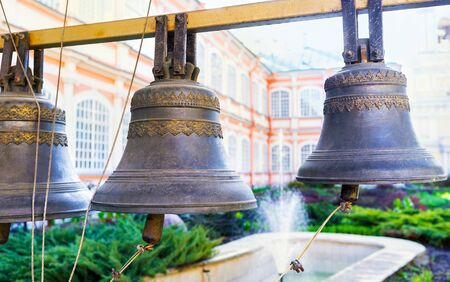 lavra: The old monastery bells in Alexander Nevsky Lavra with the fountain on the background, Saint Petersburg, Russia. Stock Photo