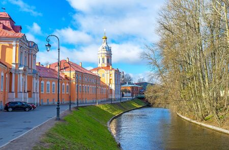 The colorful Northen (Prosfornyi) Building and the Riznica tower of Alexander Nevsky Lavra (Monastery), located at the embankment of Monastyrka river, Saint Petersburg, Russia.