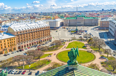 The rooftop of St Isaacs Cathedral is the best place to enjoy the ensemble of St Isaacs Square with green park, monument of Tsar Nicholas I, Mariinsky Palace, historic hotels and mansions, St Petersburg, Russia. Editorial