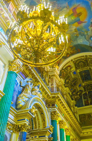 SAINT PETERSBURG, RUSSIA - APRIL 25, 2015: The St Isaacs Cathedral boast unique and splendid decorations of different technics, making it one of the most interesting and expencive object of art, on April 25 in Saint Petersburg. Editorial