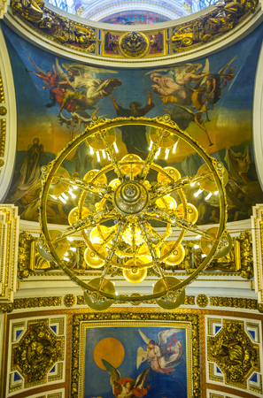 sobor: SAINT PETERSBURG, RUSSIA - APRIL 25, 2015: The chandelier and painted ceiling of St Isaacs Cathedral, depicting the scenes from Holy Bible, on April 25 in Saint Petersburg. Editorial