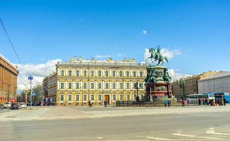 SAINT PETERSBURG, RUSSIA - APRIL 25, 2015: The monument of Tsar Nicholas I, located in St Isaacs Square, with the neoclassical building of Vavilov Institute of Plant Industry on the background, on April 25 in Saint Petersburg. Editorial