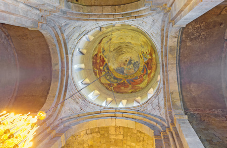 MTSKHETA, GEORGIA - JUNE 6, 2016: The stone dome of Svetitskhoveli Cathedral with the fragments of old fresco, on June 6 in Mtskheta. Editorial