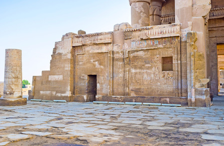 The walls of the ancient Kom Ombo Temple covered with preserved reliefs, depicting Egyptian Gods, Egypt.