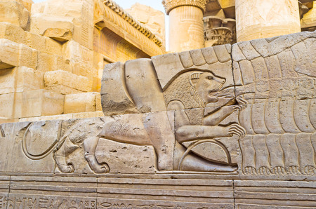 The relief with the running lion, biting the slaves hand, Kom Ombo Temple, Egypt.