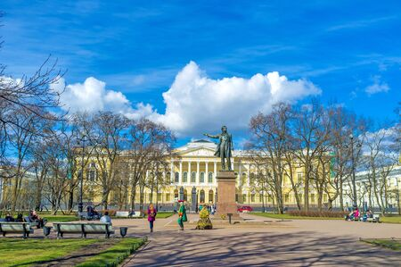 SAINT PETERSBURG, RUSSIA - APRIL 25, 2015: The bronze monument to Alexander Pushkin, located in the Arts Square at the facade of State Russian Museum, on April 25 in Saint Petersburg.