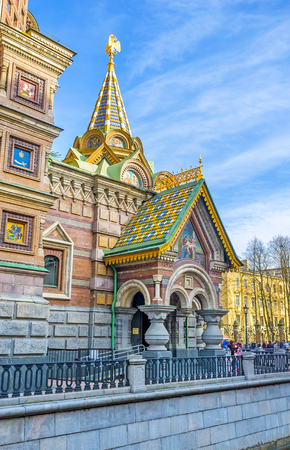 SAINT PETERSBURG, RUSSIA - APRIL 25, 2015: The porch entrance to the Church of Savior on Spilled Blood, decorated with colorful tiled roof, icons, columns, double-headed golden eagle, on April 25 in Saint Petersburg.