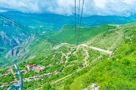 The cables of the aerial tram, famous as the Wings of Tatev, connecting Halidzor village with the Tatev Monastery, Syunik, Province, Armenia. Stock Photo