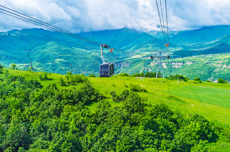 tatev: The best way to enjoy the sites of Syunik Province is to ride on the Wings of Tatew aerial tram to the Tatev Monastery above the Vorotan river canyon, Armenia.