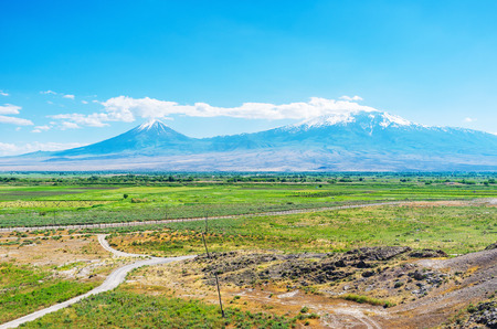 The view of the Ararat Plain and Greater Ararat Mount with snowy tops from the hill of Khor Virap Monastery, Pokr Vedi village, Armenia.