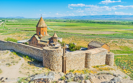 The historic Khor Virap Monastery surrounded by the fortress wall and located on the hill among Ararat Plain, Pokr Vedi, Armenia.