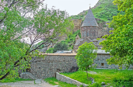 The garden at the fortress wall of Geghard Monastery, medieval complex, that originates from the Holy Spear, Kotayk Province, Armenia.